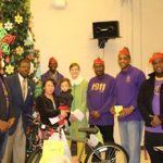 Chi Gamma Gamma delivering gifts